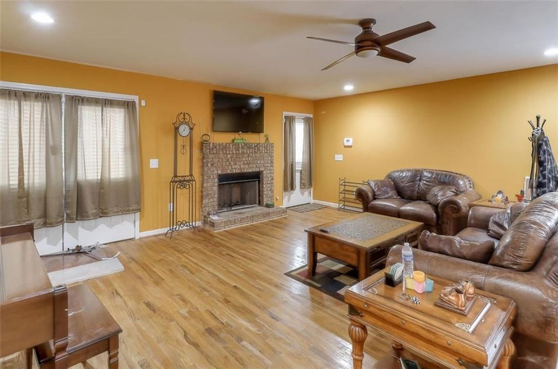 A huge living room with yellowish walls.