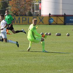 Issa Rayyan delivers the pass after getting around the keeper to a streaking Justin McMaster