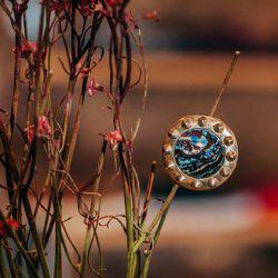<b>Urban Boulder x Space</b> NYC Rock 'n' Roll Opal pin, $85