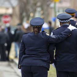 Police officers comfort each other at the funeral for Chicago Police Officer John P. Rivera. | Ashlee Rezin/Sun-Times