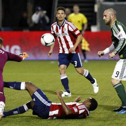 Chivas USA goalie Dan Kennedy, left, dives for the ball as James Riley lays on the ground before Portland Timbers' Kris Boyd (9) scores while Chivas USA's Heath Pearce (3) watches in the first half of an MLS soccer match, Saturday, April 7, 2012, in Portland, Ore.
