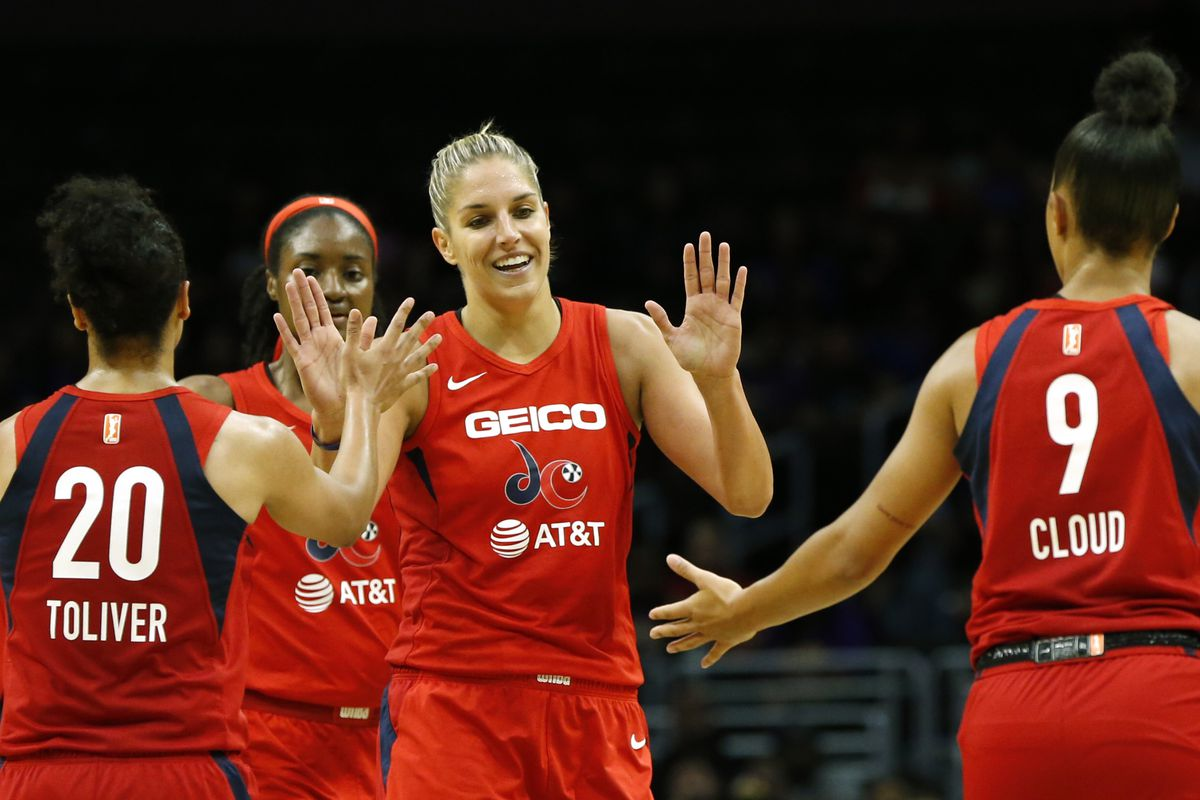 Forward Elena Delle Donne #11 of the Washington Mystics (C) high-fives teammates guard Kristi Toliver #20 and guard Natasha Cloud #9 during a game against the Los Angeles Sparks at Staples Center on June 18, 2019 in Los Angeles, California. (Photo by Kath
