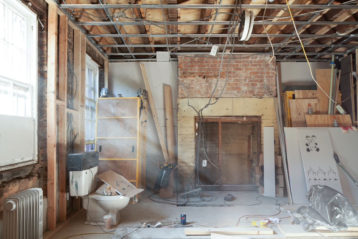 Part Iv Systems Management Or Rewiring From Top To Bottom Curbed How Much Does Your House Cost During This Phase Of Demolition And Installation Buck His Team Found A Fireplace In What Would Become The Garden Level Apartment