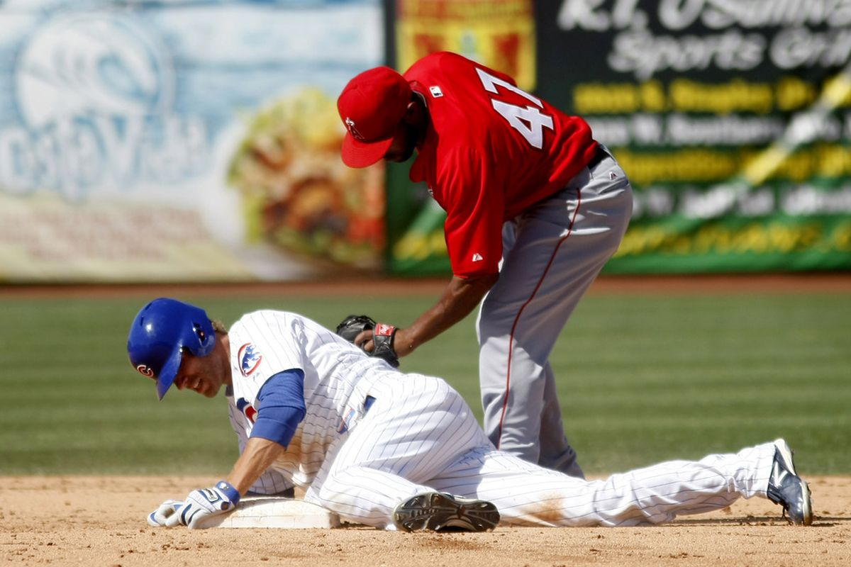 Mesa, AZ, USA; Chicago Cubs right fielder Joe Mather slides into second base safely in front of Los Angeles Angels second baseman Howard Kendrick in the fifth inning at HoHoKam Stadium. Credit: Rick Scuteri-US PRESSWIRE