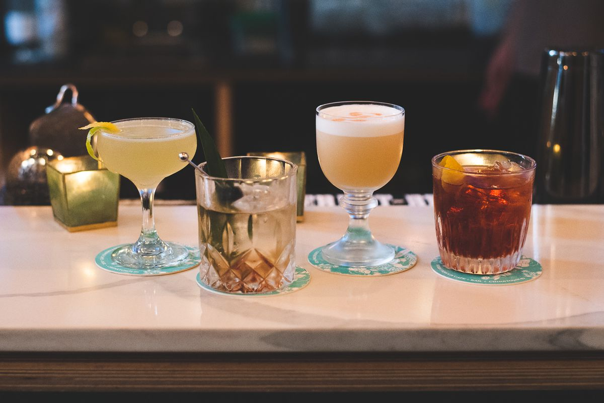 An assortment of cocktails on the bar at Hood Famous Cafe and Bar.