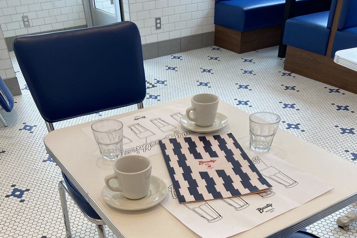 inside of diner with mosaic tiling