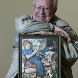 Tom Paquin of North Bennington, Vt., poses with a1950 Saturday Evening Post cover illustration by Norman Rockwell for which he modeled at the Bennington Museum on Friday, Sept. 28, 2012, in Bennington, Vt.
