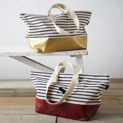 """""""Another bag that has caught my eye recently is the <b>Baggu x West Elm</b> <a href=""""http://www.westelm.com/products/baggu-striped-weekender-baggu-dipped-weekender-bag-striped-d1874/"""">Dipped Weekender</a> ($99). It's vinyl dipped on the bottom in either g"""