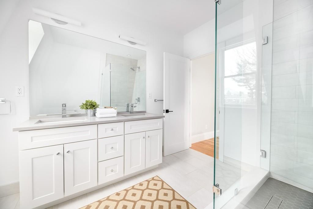A bathroom with a glass side on the shower, which is otherwise open.