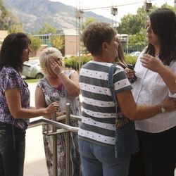 Family and friends of Dallin Todd Morgan, 18, hug each other outside 2nd District Court in Ogden. Morgan pleaded no contest Thursday, Aug. 30, 2012, to criminal mischief in a plot to bomb an assembly at Roy High School earlier this year. He was ordered to serve 105 days in jail and up to 18 months probation.