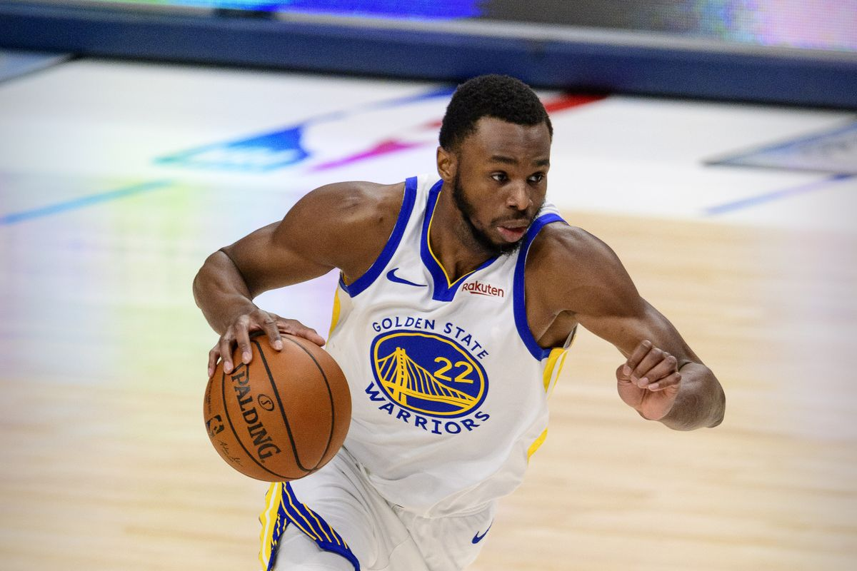 Golden State Warriors forward Andrew Wiggins in action during the game between the Dallas Mavericks and the Golden State Warriors at the American Airlines Center.