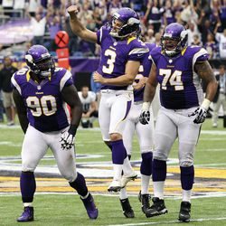 Minnesota Vikings kicker Blair Walsh (3) celebrates with Fred Evans, left, and Charlie Johnson, right, after kicking a field goal in the closing seconds of the second half of an NFL football game against the Jacksonville Jaguars, Sunday, Sept. 9, 2012, in Minneapolis. The Vikings won 26-23 in overtime.