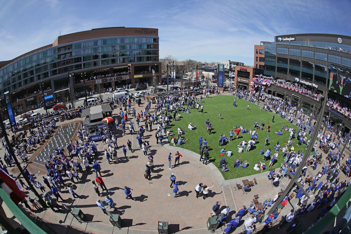 Fans gather in April at Gallagher Way, the plaza next to the west side of Wrigley Field.