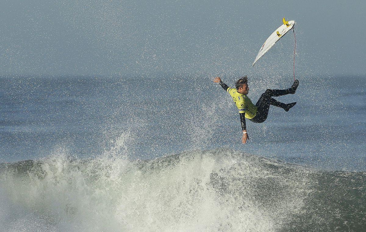 Surfer Dane Reynolds flies over a wave at Ocean Beach in San Francisco.