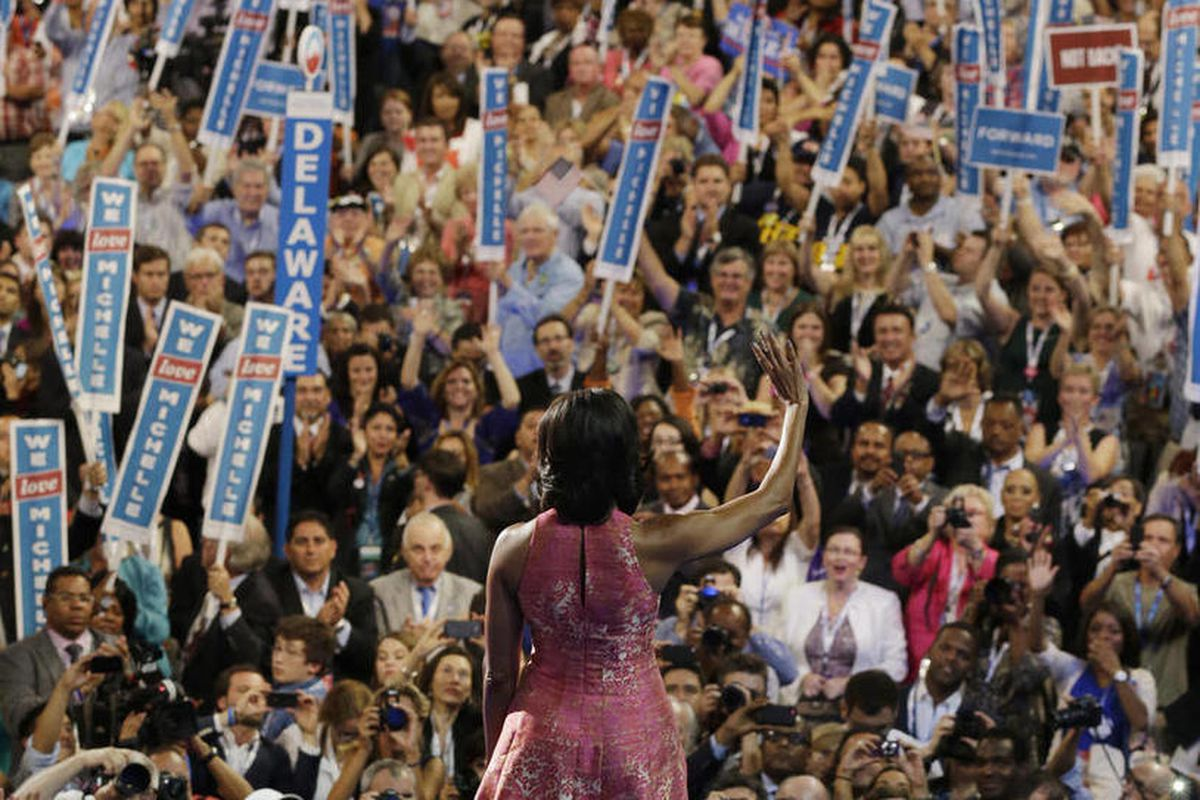 First Lady Michelle Obama waves after speaking at the Democratic National Convention in Charlotte, N.C., on Tuesday, Sept. 4, 2012.