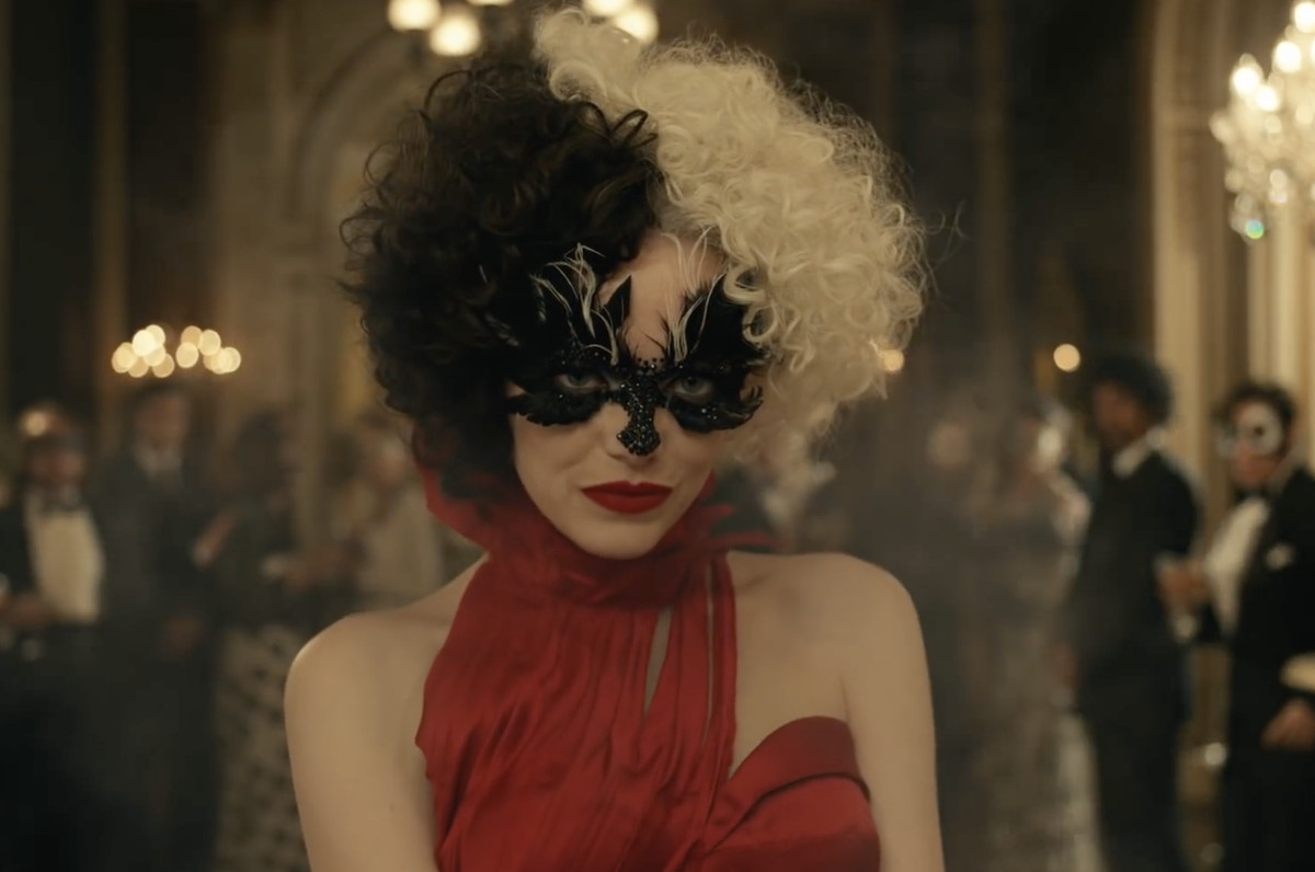cruella de vil in a fabulous masquerade mask and red gown