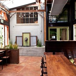 The courtyard with seats for daytime use by Salumeria's customers.