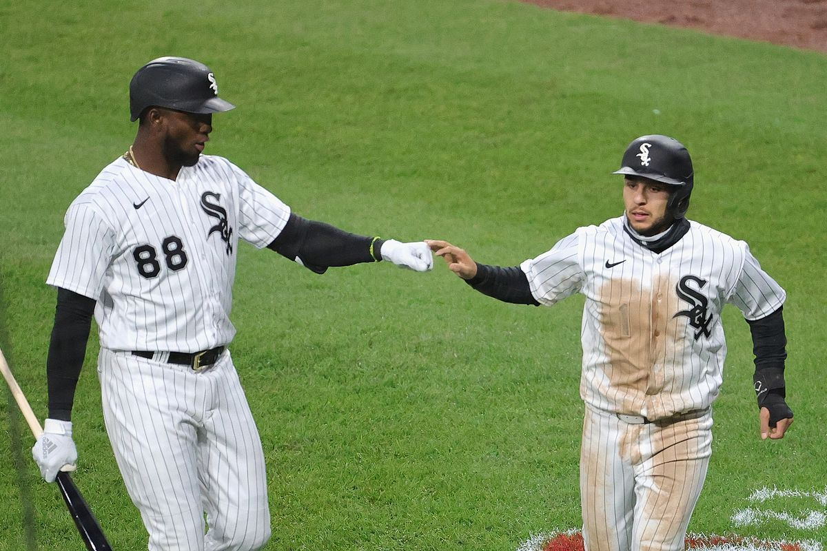 Luis Robert, left, and Nick Madrigal are two major injury losses for the White Sox.