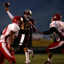 Lone Peak's Tannon Pedersen delivers a pass against American Fork Friday night.
