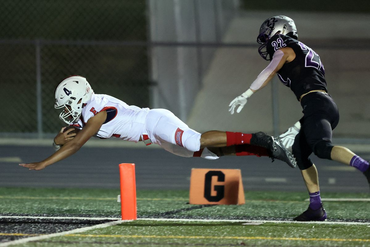 East's Siona Vailahi dives into the end zone for a score against Riverton last year.