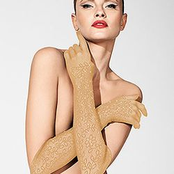 <b>2. Yasmin Lace Elbow Length Gloves,</b> $155: These lace elbow length gloves are a lighter alternative to satin. Almost as dramatic as black, the beige color is eye-catching and the lace will keep your arms cool in the summer heat. Available at Wolford