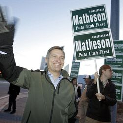 Jim Matheson campaigns during a honk and wave at 13400 South and Bangerter Highway in Riverton on Friday, Nov. 2, 2012.