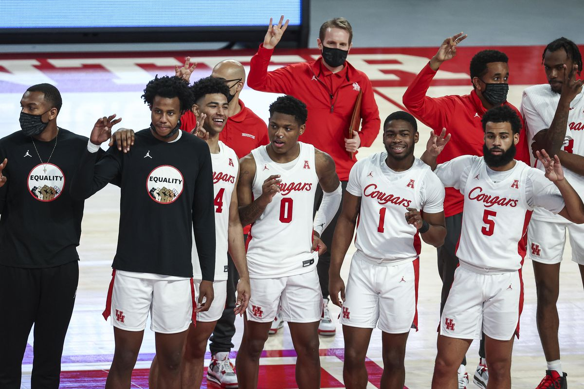 Houston Cougars guard Marcus Sasser celebrates with teammates after defeating the Southern Methodist Mustangs at Fertitta Center.