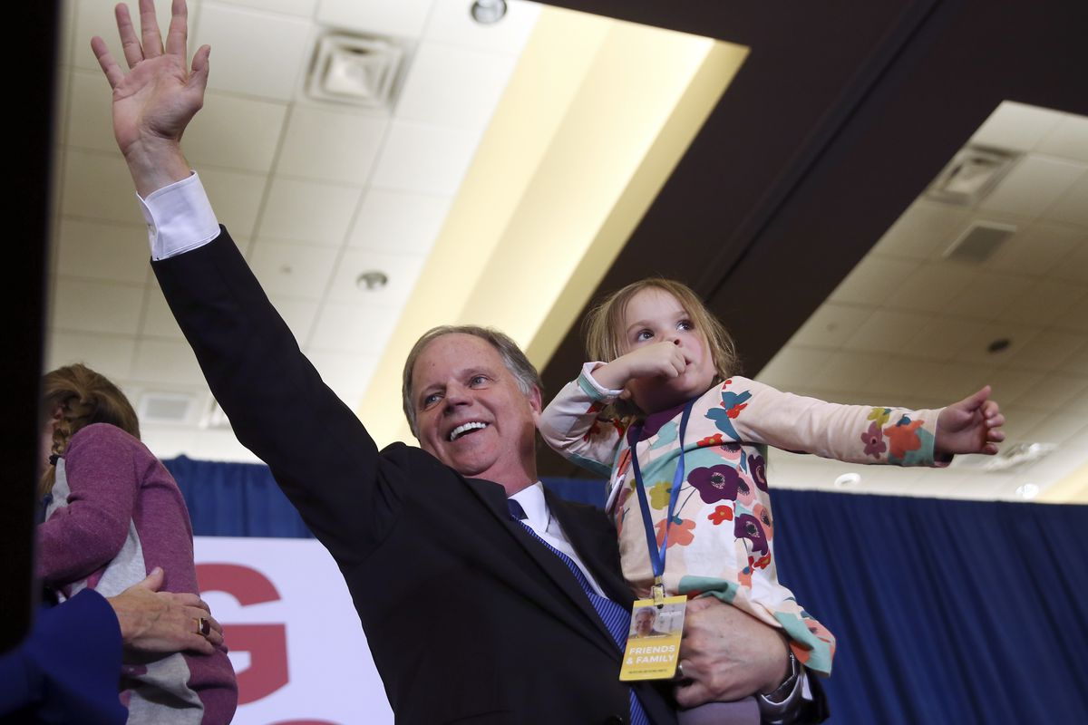 Doug Jones waves to supporters before speaking during an election-night watch party Tuesday, Dec. 12, 2017, in Birmingham, Ala. Jones won election to the U.S. Senate from Alabama, dealing a political blow to President Donald Trump.