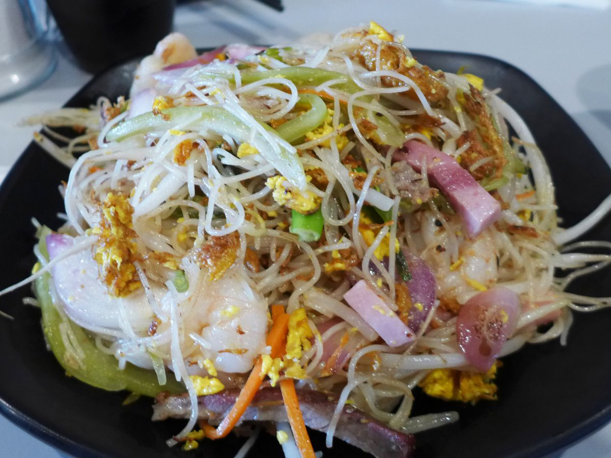 A plate of stir fried rice vermicelli with ham