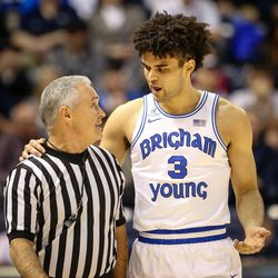 Brigham Young Cougars guard Elijah Bryant (3) speaks with a referee in the first half as the BYU Cougars take on the Saint Mary's Gaels in the Marriott Center in Provo on Saturday, Dec. 30, 2017.