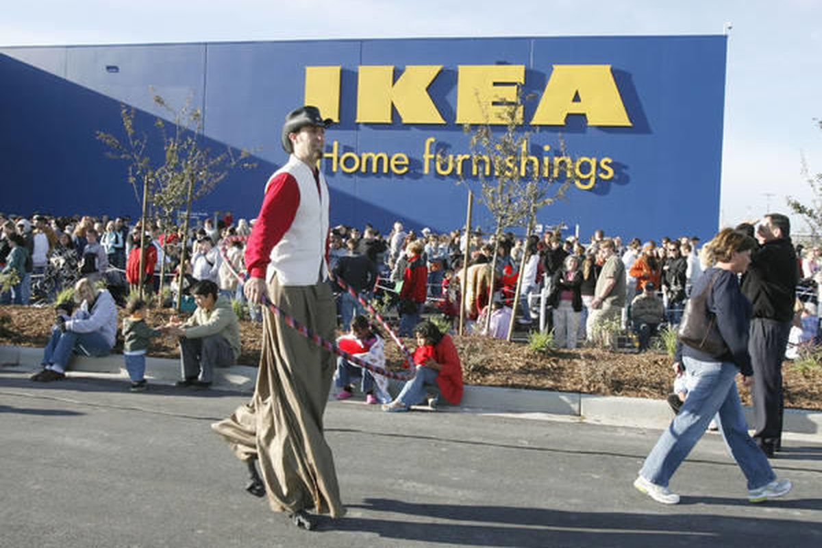 Patrons and entertainers wait for the IKEA grand opening in Draper, Utah, May 23, 2007.