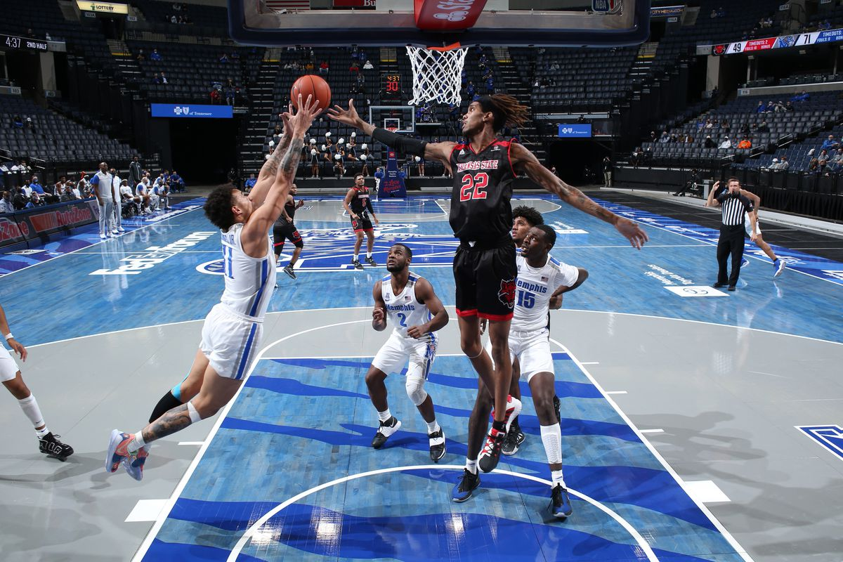 Lester Quinones of the Memphis Tigers grabs a rebound against Keyon Wesley of the Arkansas State Red Wolves during a game on December 2, 2020 at FedExForum in Memphis, Tennessee.