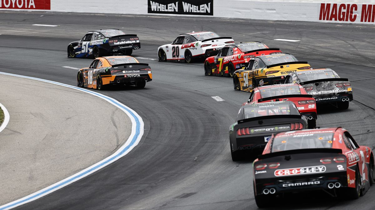 Cars hit turn 2 during the Xfinity Series - Ambetter Get Vaccinated 200 on July 17, 2021 at New Hampshire Motor Speedway in Loudon, New Hampshire.