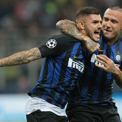 Mauro Emanuel Icardi (L) of FC Internazionale celebrates his goal with his team-mate Radja Nainggolan during the Group B match of the UEFA Champions League between FC Internazionale and Tottenham Hotspur at San Siro Stadium on September 18, 2018 in Milan, Italy.