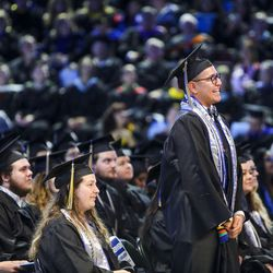 Salt Lake Community College graduate of excellence Gabe Moreno stands to receive recognition during the 2017 commencement ceremony at the Maverik Center in West Valley City on Friday, May 5, 2017.