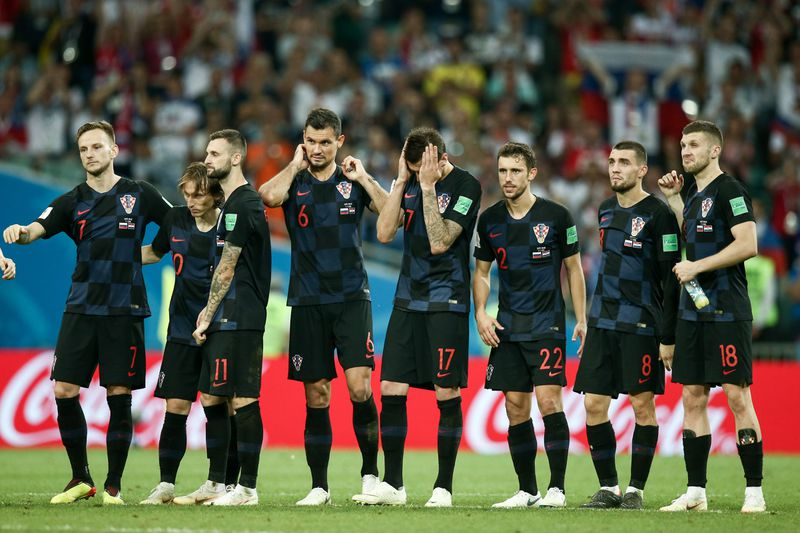 Croatian players look on during a penalty shootout in the 2018 FIFA World Cup Quarterfinal match against Russia.