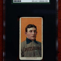 FILE - This March 26, 2012, file photo shows a rare 1909 Honus Wagner baseball card, one of the most sought-after sports collectibles in the world, in a protective casein Sunset Hills, Mo.  A New Jersey man, whose name has not been released, was the winning bidder for the rare baseball card _ at $1.2 million _ in an online auction that ended Friday, April 20, 2012.