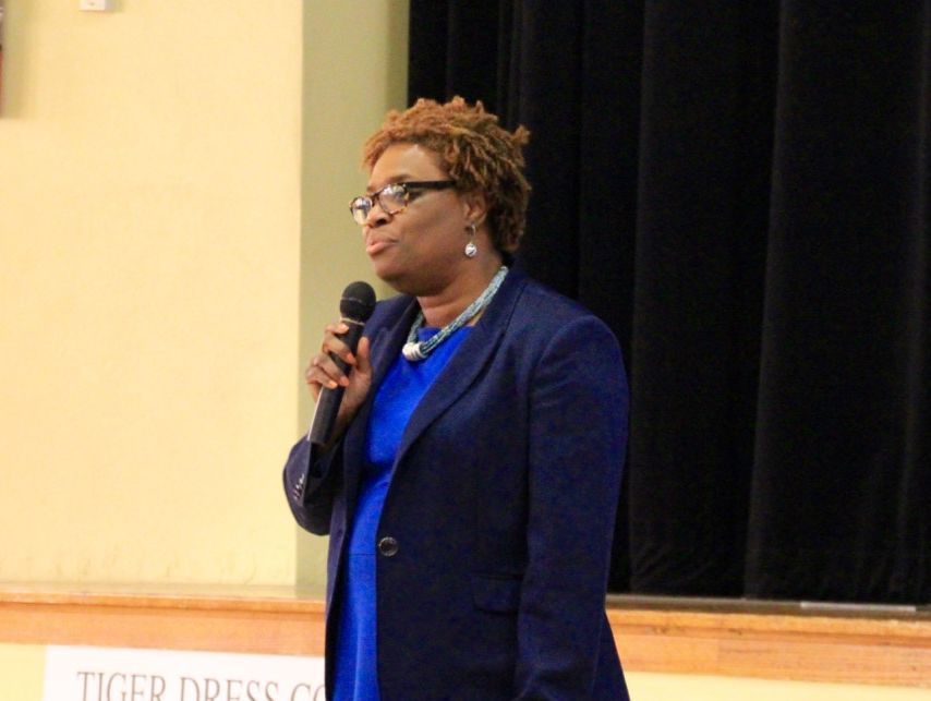 Yetta Lewis, co-founder and CEO of Gestalt Community Schools, answers questions from parents and teachers during an October assembly at Humes Preparatory Academy Middle School.