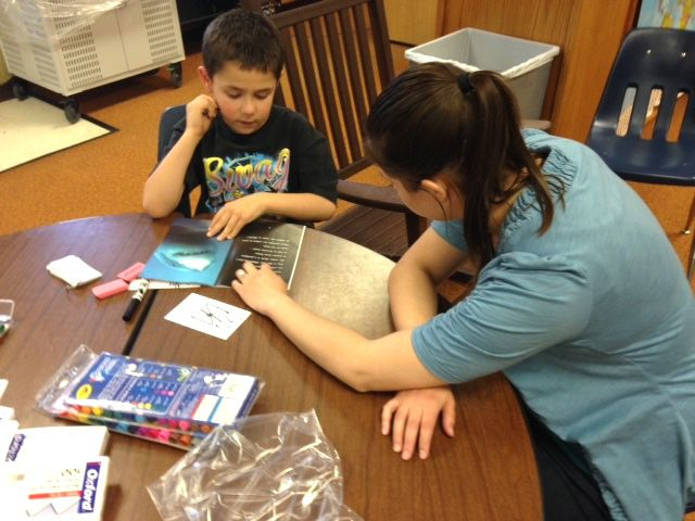 A Blocks of Hope volunteer works with a Tennyson Knolls student during a Friday afternoon tutoring session last spring.