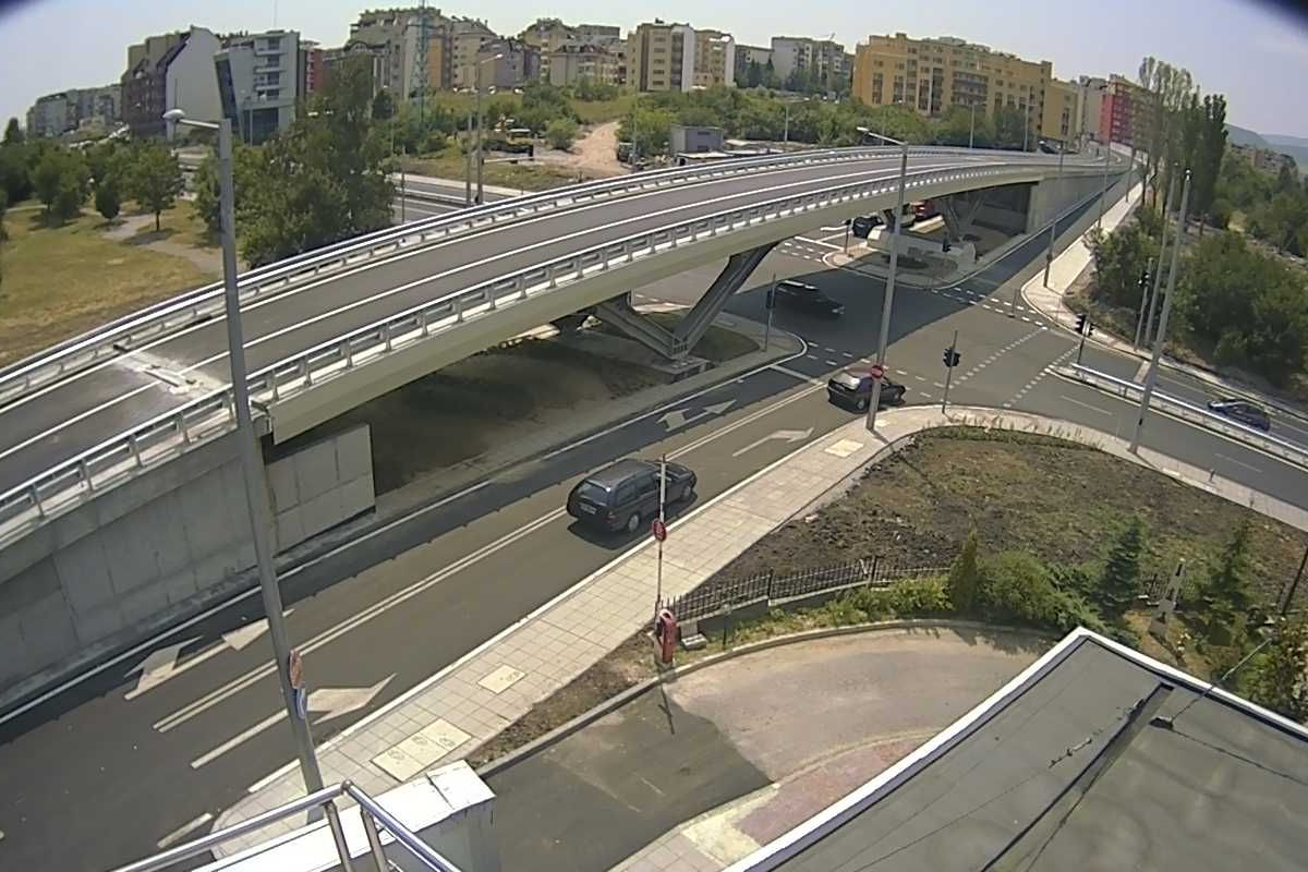 A conventional intersection with a bridge on top to carry through-traffic.