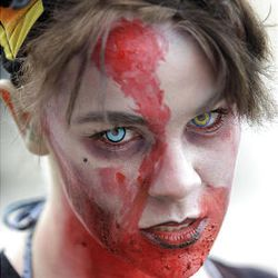 Zombie Walk participant Emily Carbone strolls the streets of Salt Lake City on Sunday.