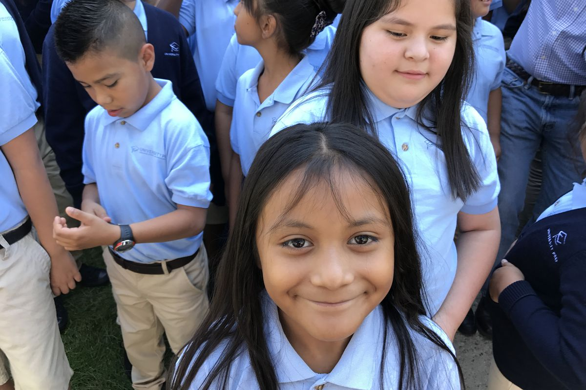 A student at University Prep Steele Street in Denver smiles at a celebration of the school's test scores in August 2017.