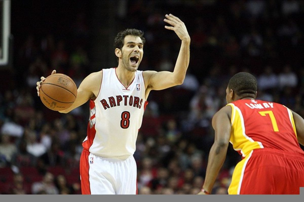 Feb 28, 2012; Houston, TX, USA; Toronto Raptors point guard Jose Calderon (8) calls a play while defended by Houston Rockets point guard Kyle Lowry (7) during the first quarter at the Toyota Center. Mandatory Credit: Thomas Campbell-US Presswire