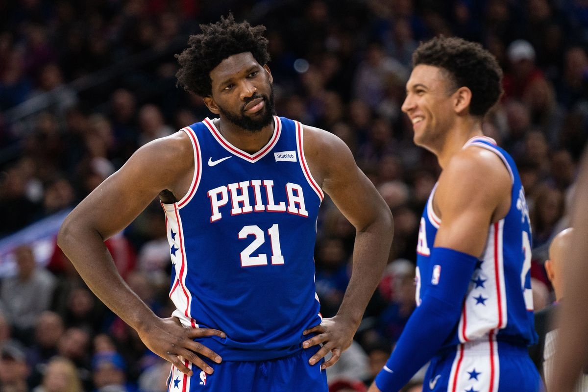 Philadelphia 76ers center Joel Embiid reacts with guard Matisse Thybulle after his missed dunk and foul during the fourth quarter at Wells Fargo Center.
