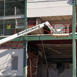 11:07 a.m. Demolition above the main gate area -