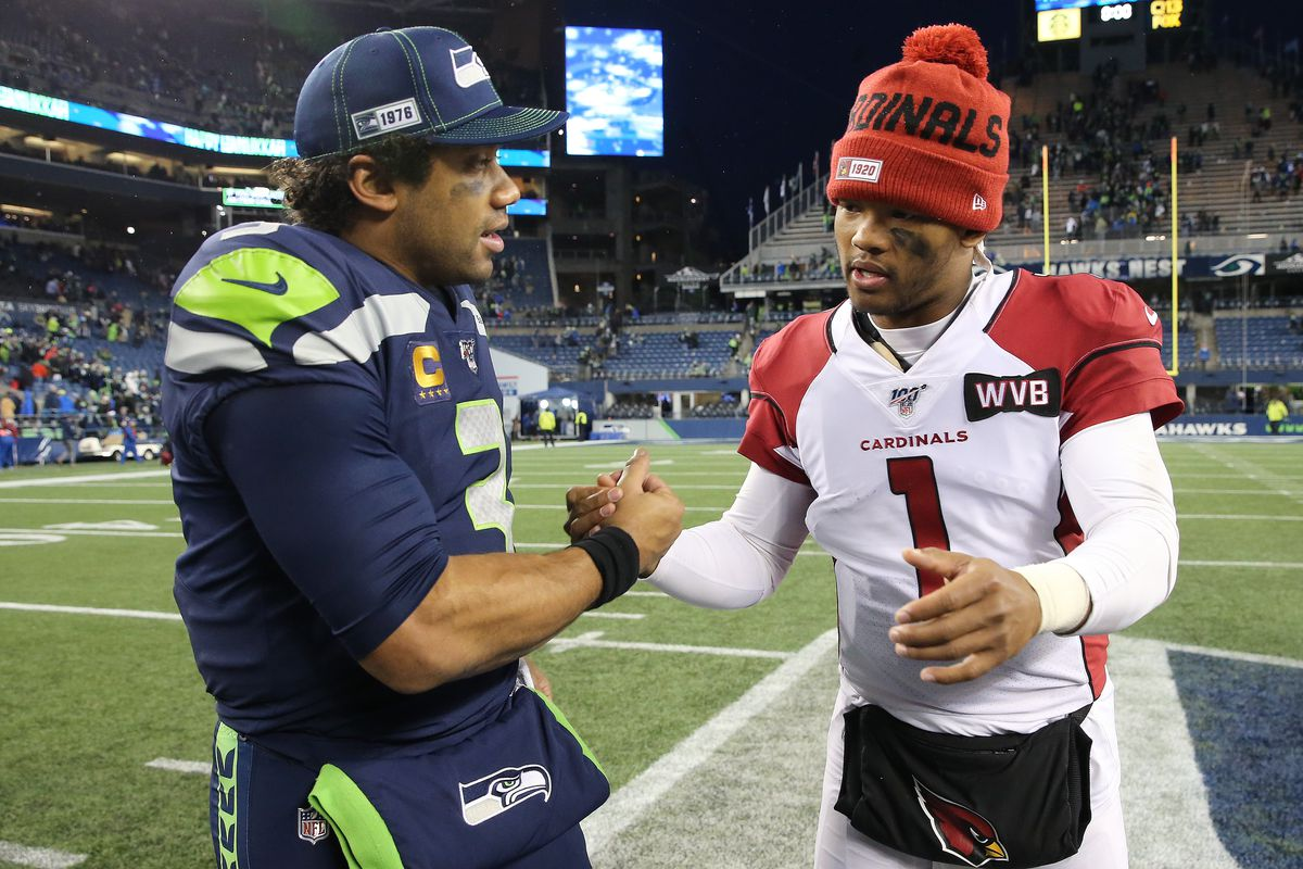 Russell Wilson of the Seattle Seahawks and Kyler Murray of the Arizona Cardinals shake hands after the Arizona Cardinals defeated the Seattle Seahawks 27-13 during their game at CenturyLink Field on December 22, 2019 in Seattle, Washington.