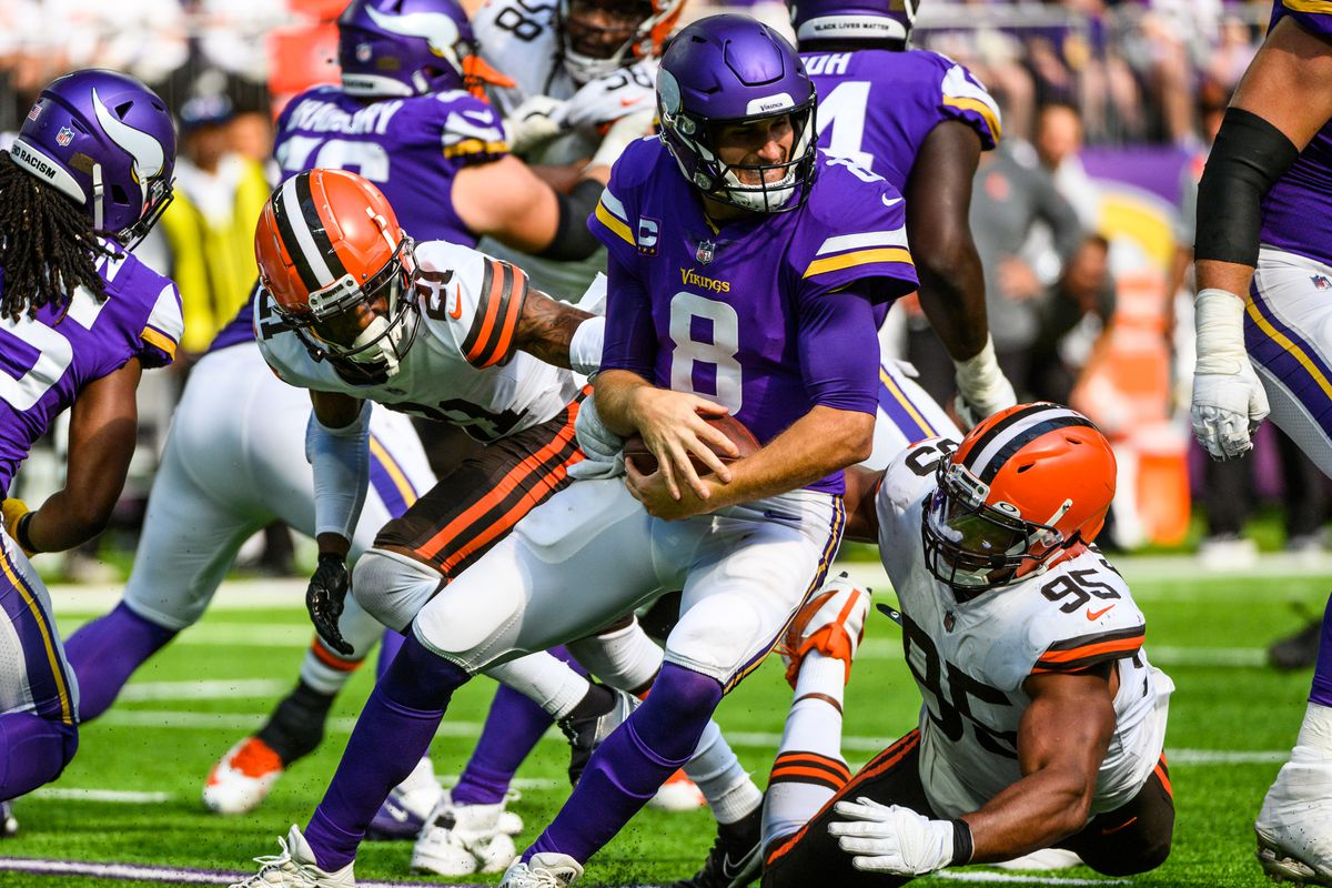 Kirk Cousins #8 of the Minnesota Vikings is sacked with the ball by Myles Garrett #95 of the Cleveland Browns in the third quarter of the game at U.S. Bank Stadium on October 3, 2021 in Minneapolis, Minnesota.