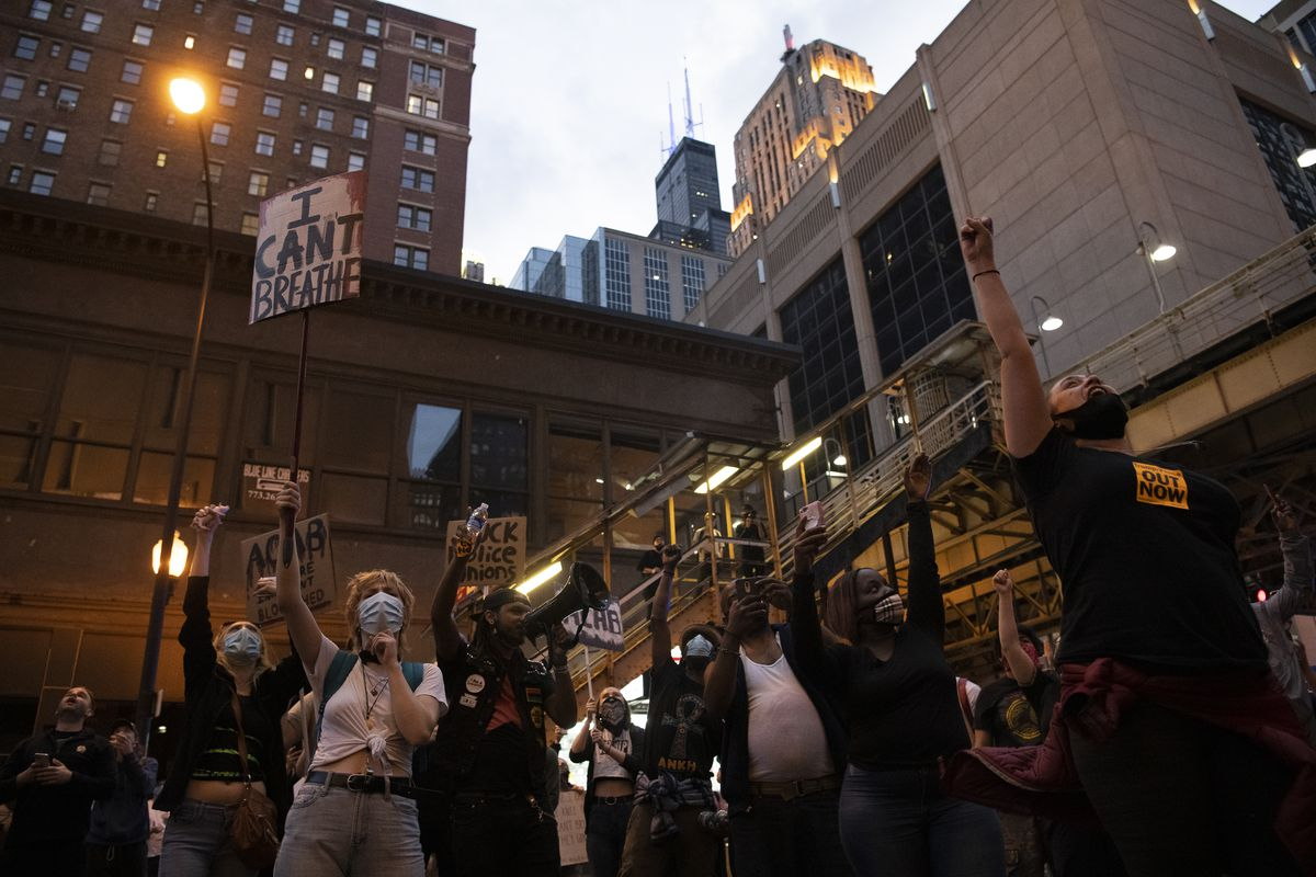 Hundreds of protesters cheer after hearing the pounds and taps on the glass from the prisoners inside the Metropolitan Correctional Center, Friday, May 29, 2020.