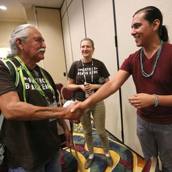 Willie Grayeyes shakes hands with Braidan Weeks after a press conference at City Creek in Salt Lake City on Thursday, Aug. 4, 2016. During the press conference, representatives of leading sports, ski, health and outdoor companies urged President Barack Obama to permanently protect the Bears Ears region in southeastern Utah.