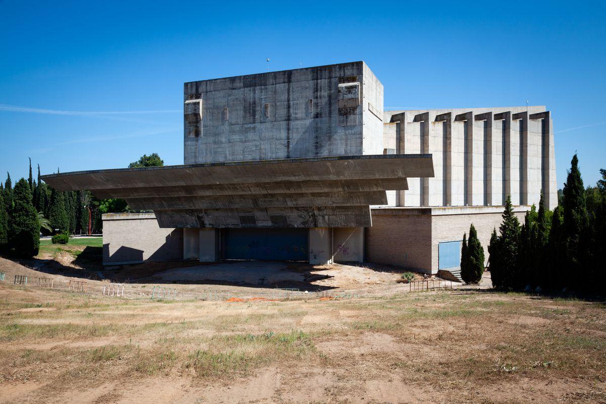 Brutalist concrete building on lawn